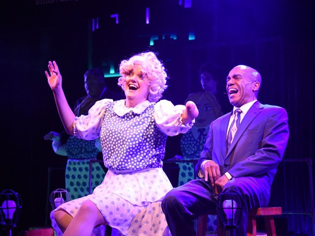 photo of Megan McGuire and Leonard Barrett as Roxie Hart and Billy Flynn