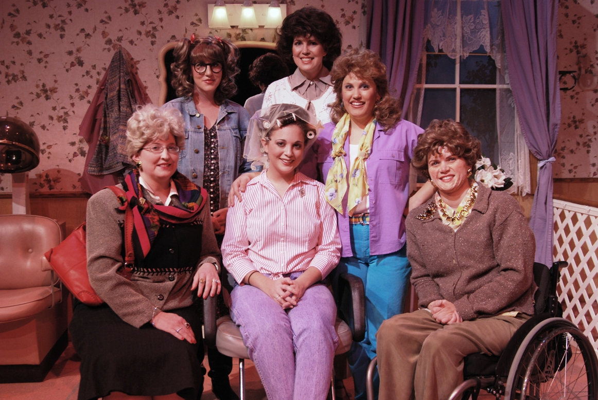 Group of women in costumes from the 80s in a salon