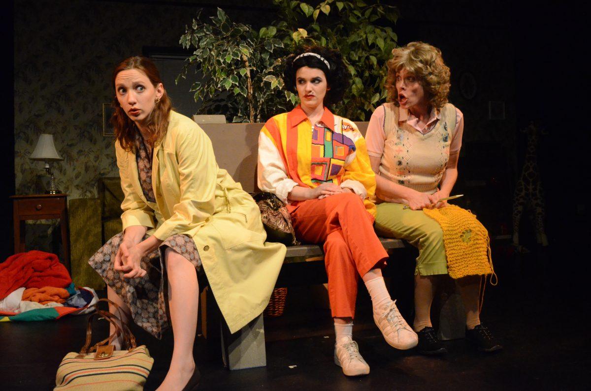 Three women sitting on bench.