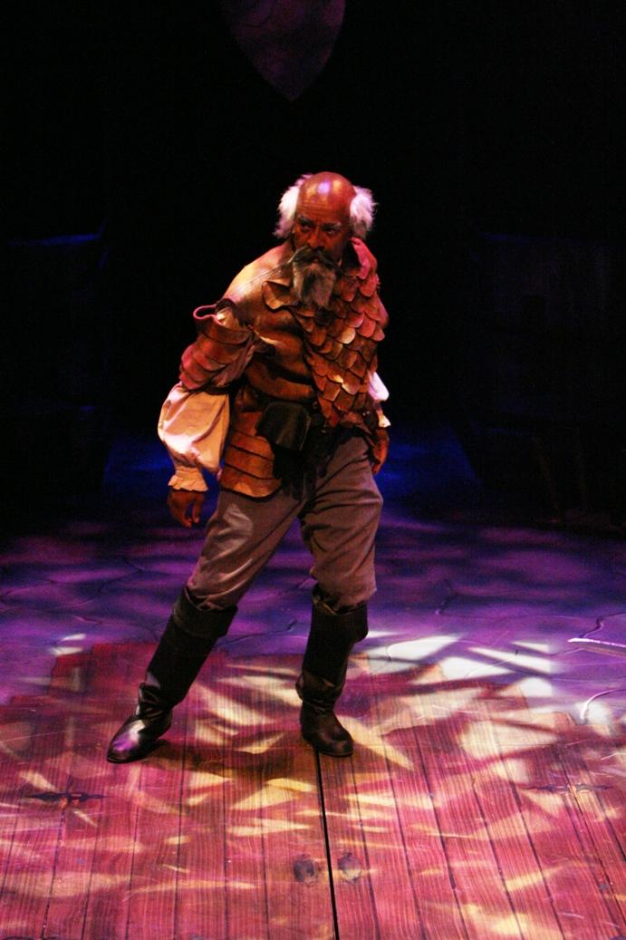 An older man dressed in battle gear